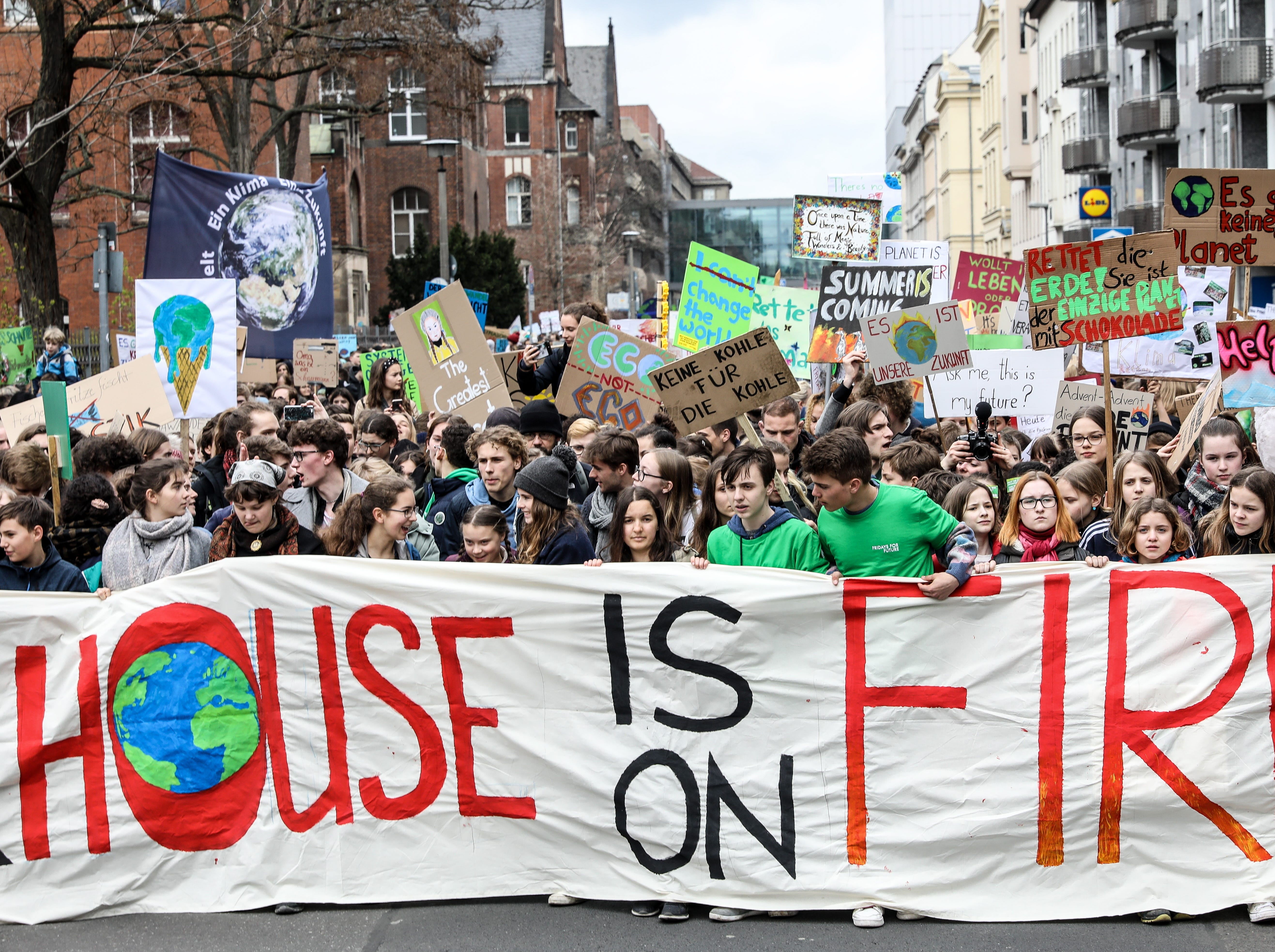 Students hold a banner during a 'Fridays for Future' demonstration against climate change in Berlin, Germany on March 29, 2019. Students across the world are taking part in a strike movement called #FridayForFuture which takes place every Friday. The movement was sparked by Greta Thunberg of Sweden, a sixteen year old climate activist, who has been protesting for climate action and the implementation of the Paris Agreement outside the Swedish parliament every Friday since August 2018.