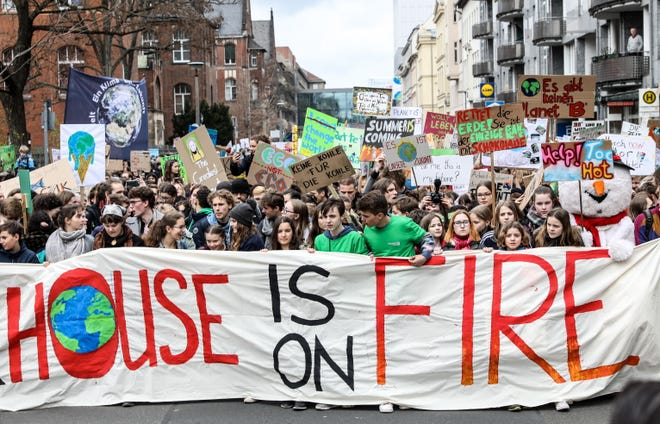 "Students hold a banner during a ""Fridays for Future"" demonstration against climate change in Berlin, Germany, on March 29, 2019. Students across the world are taking part in a strike movement called #FridayForFuture, which takes place every Friday. The movement was sparked by Greta Thunberg of Sweden, who is 16 years old."