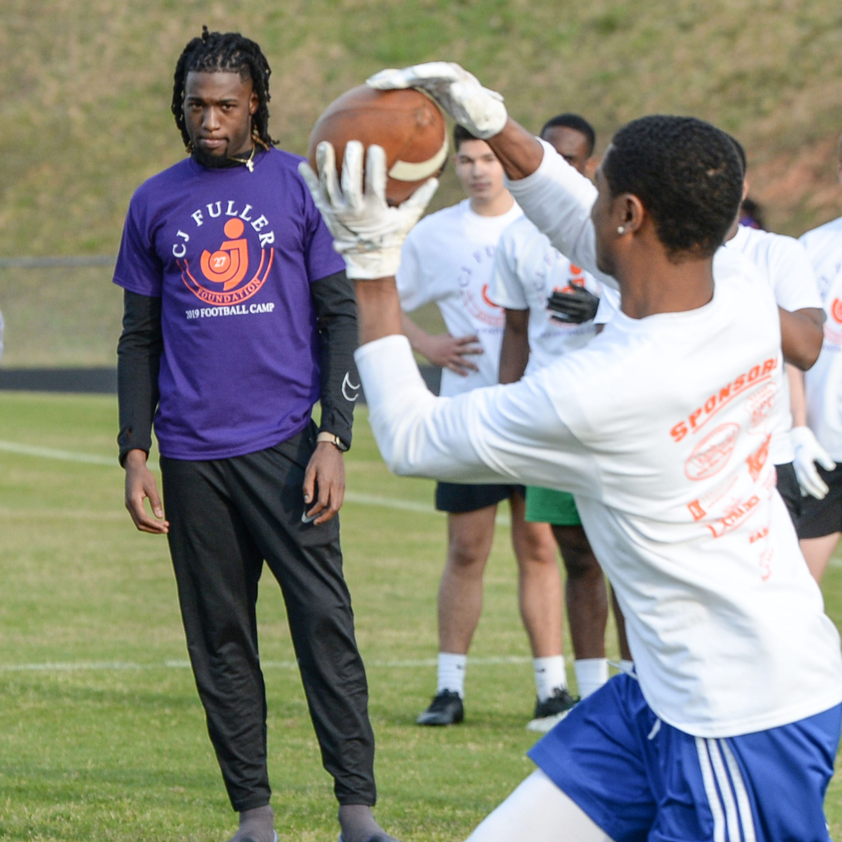 NFL and former Clemson players honor C.J. Fuller with a football camp at Easley High