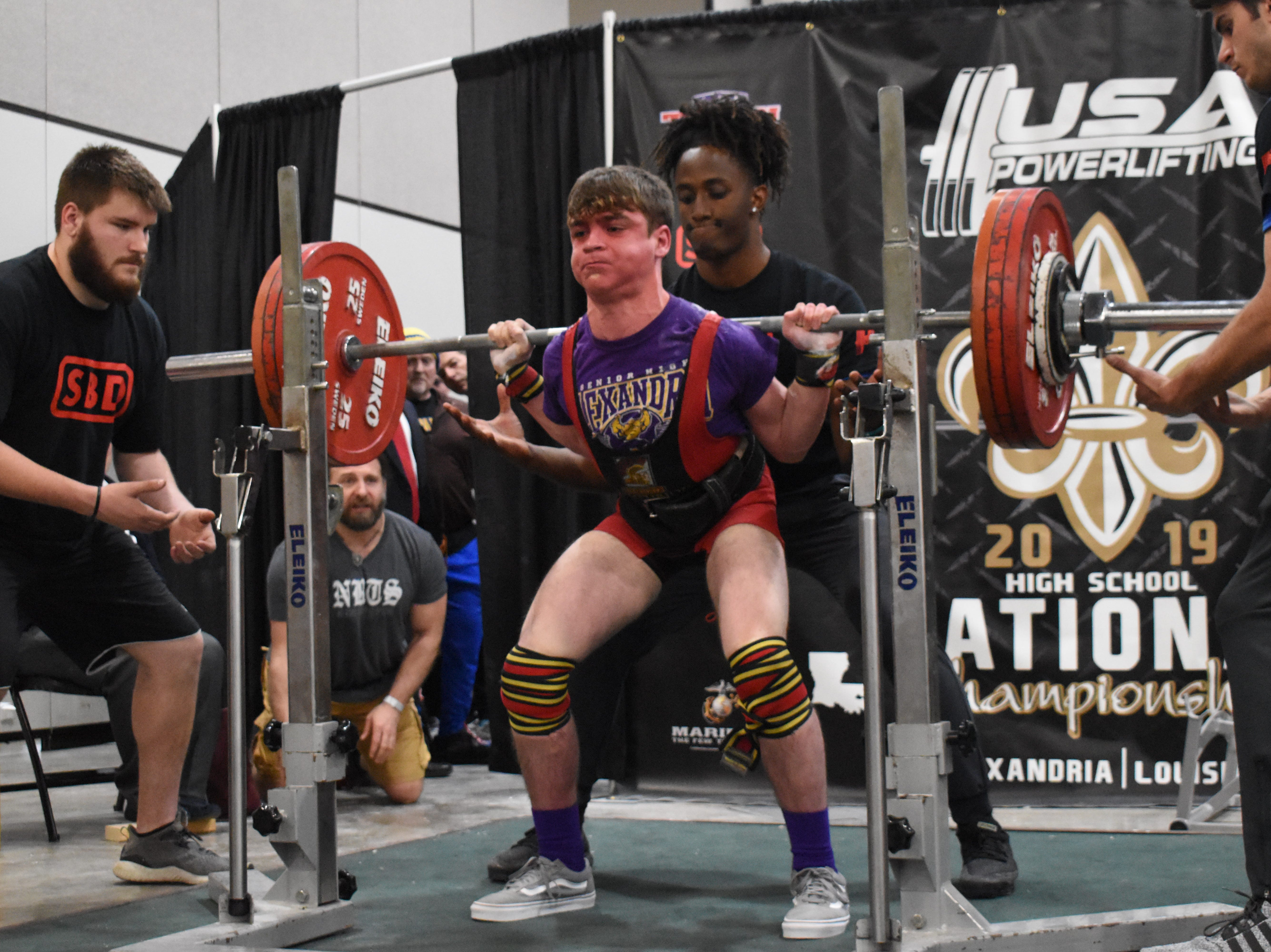 Dylan Palmer of Alexandria Senior High School performs a squat in the USA Powerlifting High School National Championships held Friday, March 29, 2019. The championships, equipped and raw, are being held at the Randolph Riverfront Center in downtown Alexandria with high school powerlifters from across the country competing in the four-day event. Powerlifters from local schools are also competing.