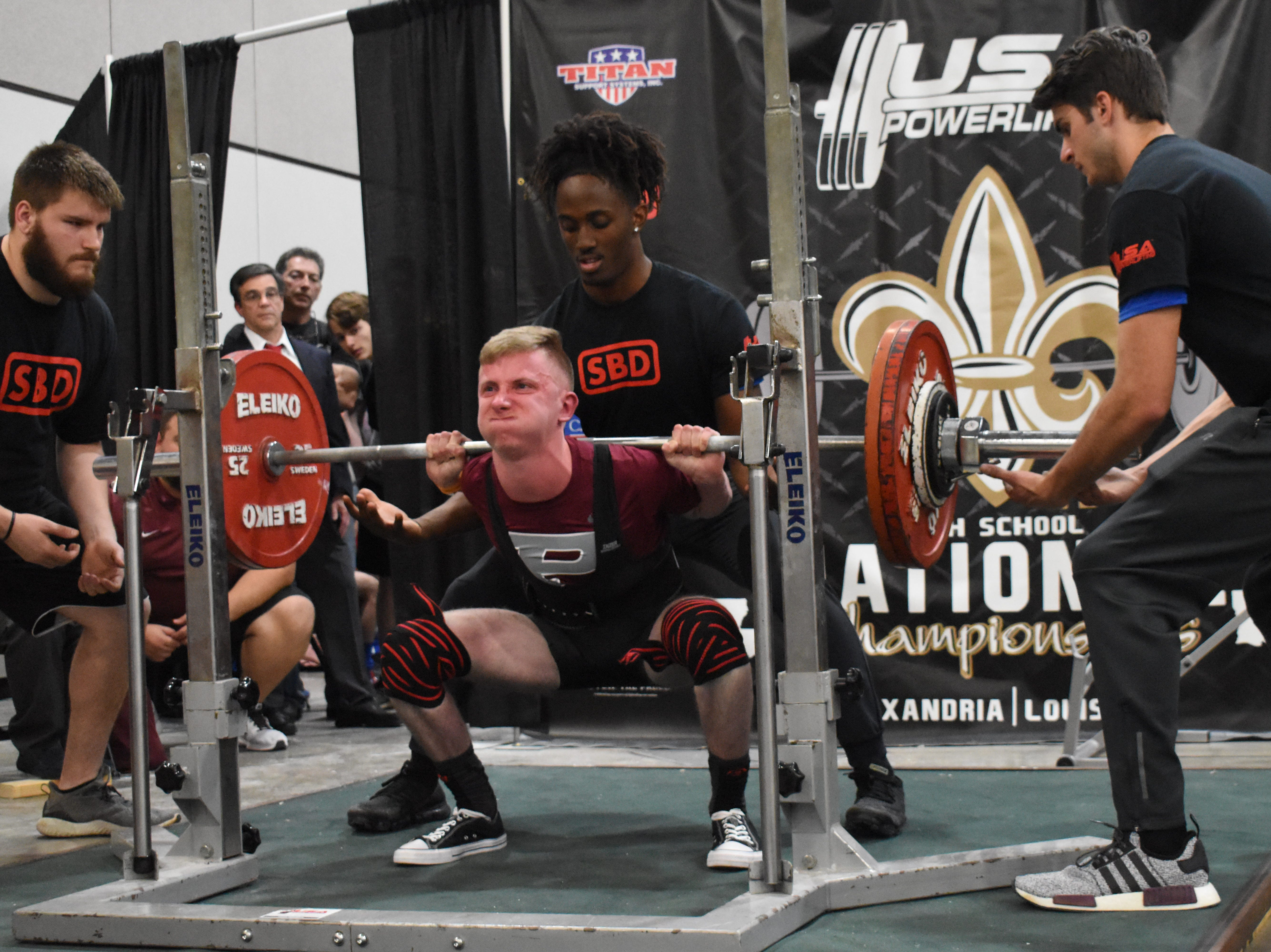 Matthew Porter of Pineville performs a squat in the USA Powerlifting High School National Championships held Friday, March 29, 2019. The championships, equipped and raw, are being held at the Randolph Riverfront Center in downtown Alexandria with high school powerlifters from across the country competing in the four-day event. Powerlifters from local schools are also competing.