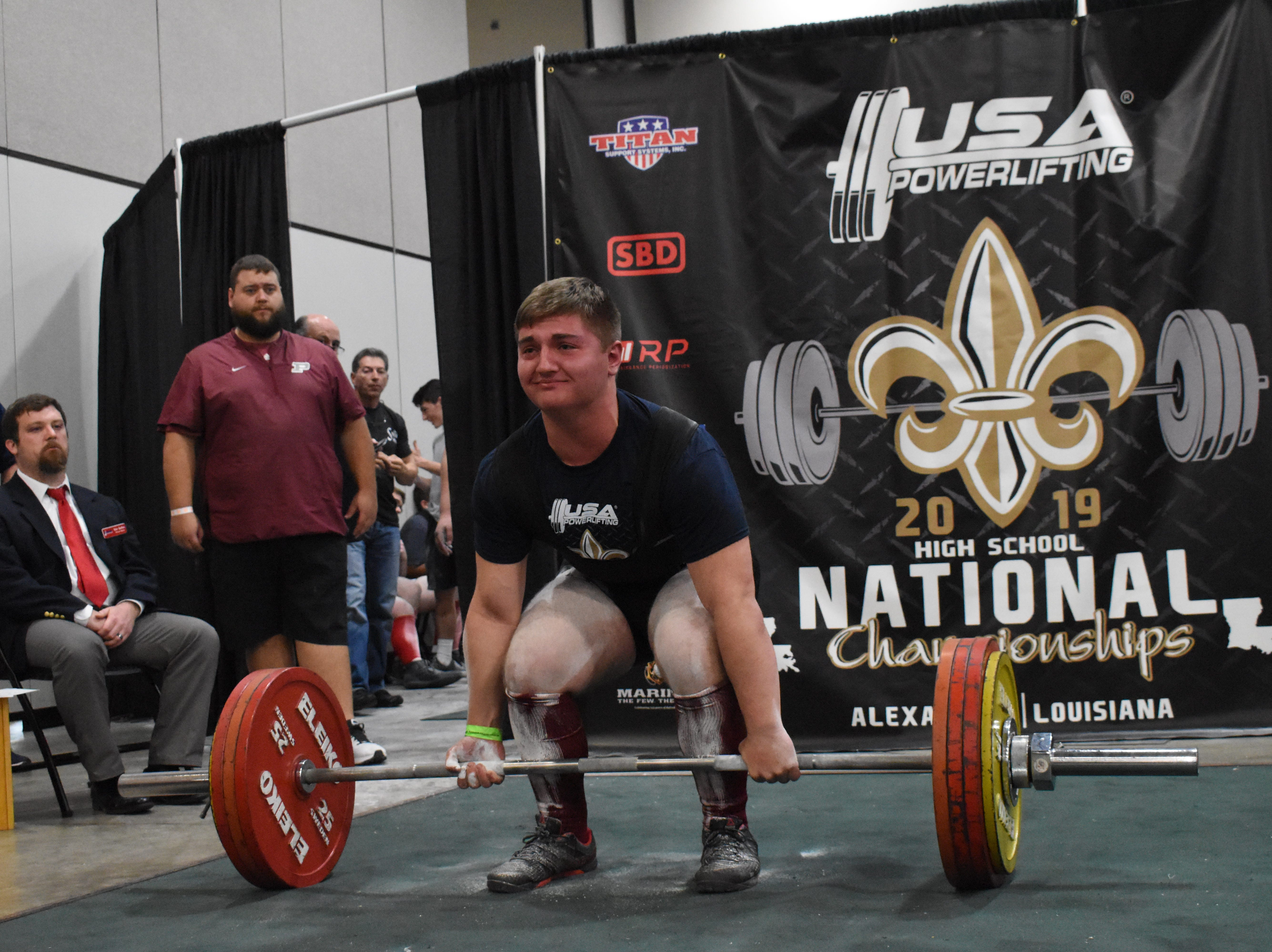 Gabriel Knapp of Pineville High School performs a deadlift in the The USA Powerlifting High School National Championships Friday, March 29, 2019. The championships, equipped and raw, are being held at the Randolph Riverfront Center in downtown Alexandria with high school powerlifters from across the country competing in the four-day event. Powerlifters from local schools are also competing.
