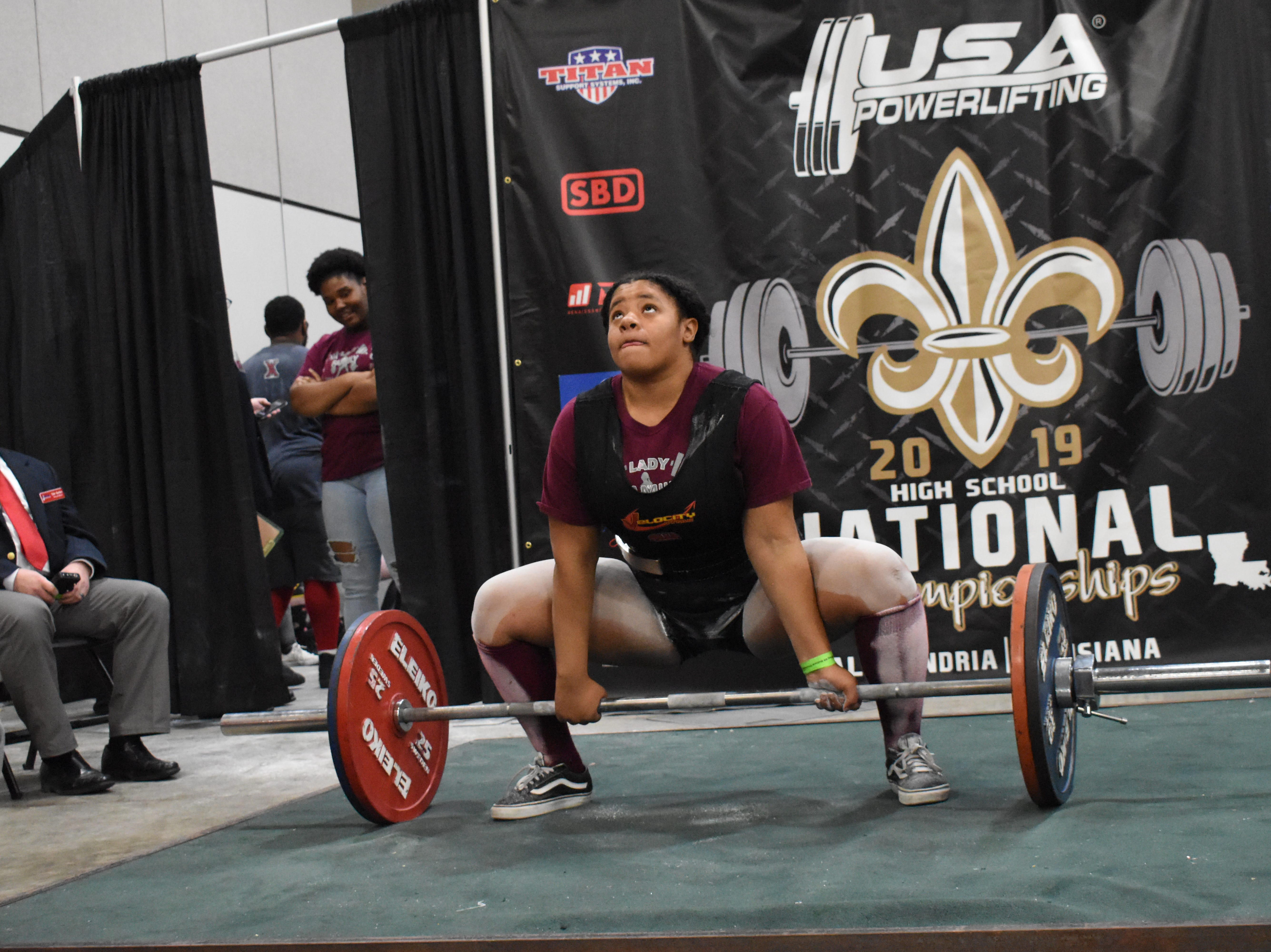 Tyreana Hughes of Pineville High School performs a deadlift in the The USA Powerlifting High School National Championships Friday, March 29, 2019. The championships, equipped and raw, are being held at the Randolph Riverfront Center in downtown Alexandria with high school powerlifters from across the country competing in the four-day event. Powerlifters from local schools are also competing.