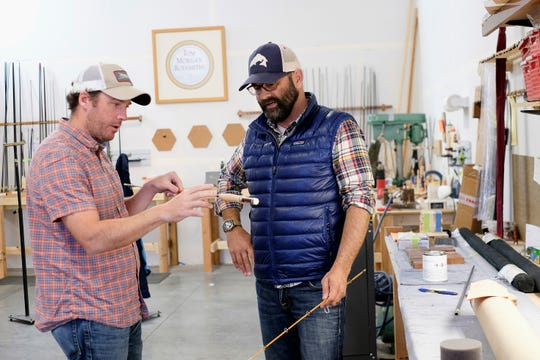 Matt Barber, left, and Joel Doub, co-owners of fishing rod manufacturer Tom Morgan Rodsmiths, inspect a rod during the build process at the company in Bozeman, Mont. When Barber and Doub bought the company two years ago, the plan was for previous owner Tom Morgan to stay with the business for five years to mentor them. But six months after the deal closed, Morgan died unexpectedly.