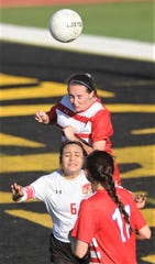 Cooper's Savannah Gregory, top, battles Lubbock Coronado's Heaven Rossette (6) for the ball. Coronado beat the Lady Cougars 4-1 in the Region I-5A bi-district playoff game Friday, March 29, 2019, at Tiger Stadium in Snyder.