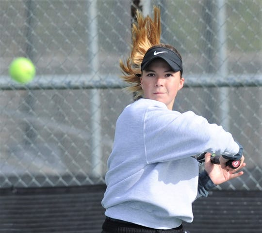 Abilene High's Katherine Morris watches her return volley in her girls doubles match against Lubbock Monterey's Gracelyn Anderson and Ashley Bustos. Morris and McKenna Bryan won the semifinal match 6-3, 4-6, 10-6 at the Sharon Wartes Abilene Eagle Invitational on Saturday, March 30, 2019, at the AHS tennis courts.