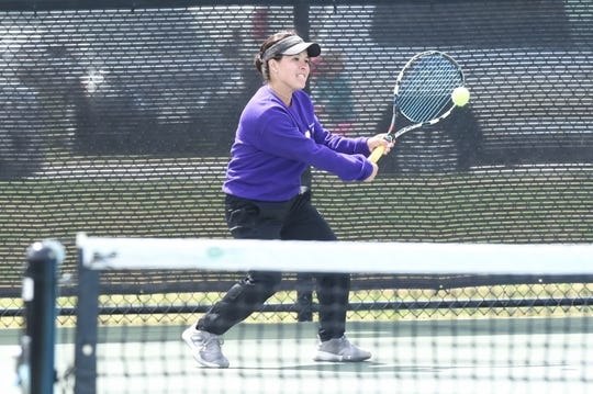 Wylie's Analeah Elias hits a backhand shot during the mixed doubles final at the Sharon Wartes Eagle Invitational on Saturday, March 30, 2019.