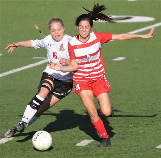 Cooper's Kristan Atikinson (4) battles Lubbock Coronado's Maykayla Herrell (16) for the ball. Coronado beat the Lady Cougars 4-1 in the Region I-5A bi-district playoff game Friday, March 29, 2019, at Tiger Stadium in Snyder.