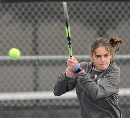 Abilene High's McKenna Bryan returns a shot during her girls doubles match against top-seeded Gracelyn Anderson and Ashley Bustos of Lubbock Monterey. Bryan and teammate Katherine Morris won the match 6-3, 4-6, 10-6 at the Sharon Wartes Eagle Invitational semifinals on Saturday, March 30, 2019, at the AHS tennis courts.