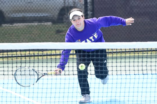 Wylie's Analeah Elias reaches for a shot at the net during the mixed doubles final at the Sharon Wartes Eagle Invitational on Saturday, March 30, 2019.
