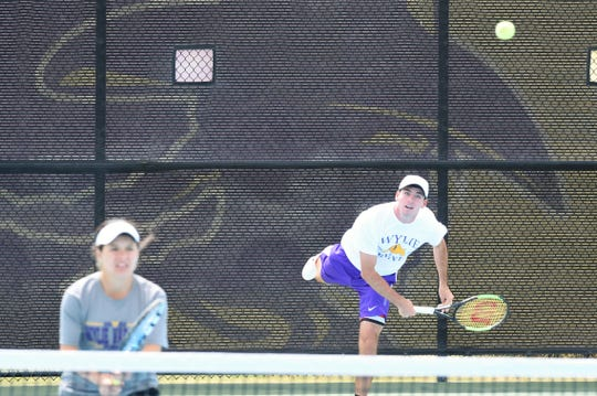 Wylie's Lane Adkins serves behind partner Analeah Elias during the mixed doubles final at the Sharon Wartes Eagle Invitational on Saturday, March 30, 2019.