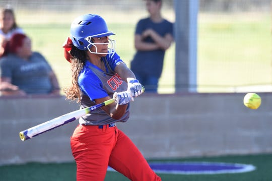 Cooper's Keiana Kemp (10) swings at a pitch against Wylie on Friday, March 29, 2019. Kemp hit a solo home run in the Lady Cougars 6-5 loss.