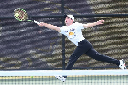 Wylie's Lane Adkins extends to reach the ball during the mixed doubles final at the Sharon Wartes Eagle Invitational on Saturday, March 30, 2019.