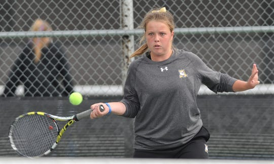 Abilene High's Rachel Tebow eyes the ball in her girls doubles match against Richland's Tori Johnson and Aaliyah Johnson at the Sharon Wartes Abilene Eagle Invitational on Saturday, March 30, 2019, at the AHS tennis courts. Tebow and teammate Lauren Schaeffer won the semifinal match 3-6, 6-1, 10-8 en route to winning the girls doubles title.