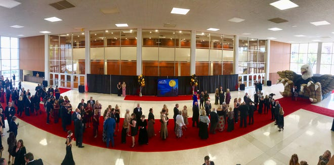"Guests arrive on the red carpet for the premiere of ""Brother's Keeper"" at the Abilene Convention Center on March 30. After photos and dinner, guests saw the movie about the 2009 Abilene High School state championship football season. A public showing followed."