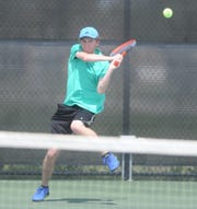 Abilene Christian High School junior Ryan Flanagan hits a backhand over the net in the boys singles final at the Sharon Wartes Abilene Eagle Invitational on Saturday, March 30, 2019, against Lewisville The Colony's Tate Nelson at Hardin-Simmons.