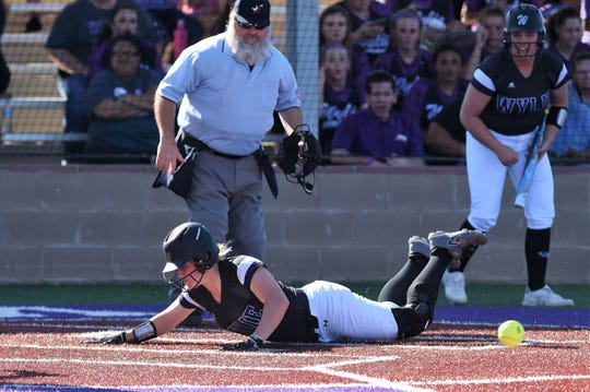 Kaylee Philipp (3) slides safely into home for Wylie's first run against Cooper on Friday, March 29, 2019. Philipp had two doubles, scored twice, drove in a run and earned the win in the circle as the Lady Bulldogs win 6-5.