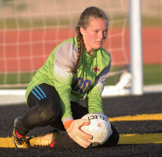 Cooper goalie Lily Crim makes a stop on a Lubbock Coronado shot in the second half. She made six saves, after finding out she would start in the game a day earlier. Coronado beat the Lady Cougars 4-1 in the Region I-5A bi-district playoff game Friday, March 29, 2019, at Tiger Stadium in Snyder.