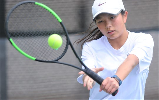 Abilene High's Ruth Hill returns a shot against Decatur's Lenka Okasova in the girls singles finals at the Sharon Wartes Abilene Eagle Invitational on Saturday, March 30, 2019, at the AHS tennis courts. Okasova won the match 2-6, 6-1, 12-8.