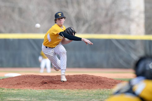 Tuscola's Jarrett Penland delivers a pitch against Asheville during their game at Asheville High School on March 29, 2019. The Cougars defeated the Mountaineers 5-4.