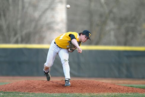 Tuscola's Hunter Bryson delivers a pitch against Asheville during their game at Asheville High School on March 29, 2019. The Cougars defeated the Mountaineers 5-4.