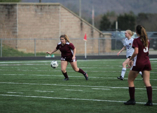 Owen junior Kelsey Beck controls the ball near midfield for the Warlassies during their sixth straight win over North Henderson on March 29.