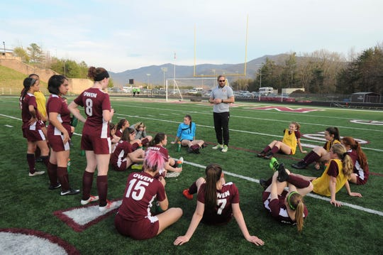 Warlassies head coach David Fiest addresses his team at the half of a 5-0 victory over North Henderson on March 29.