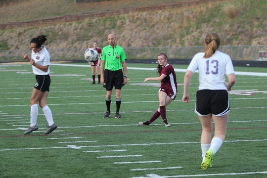 Owen senior Kayla Roseman fires a shot on the goal at home on March 29, during a 5-0 Warlassies victory over North Henderson.