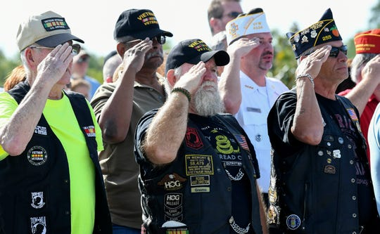 Vietnam veterans, family members and many others attend Saturday's commemoration of the 50th anniversary of the Vietnam War ceremony at Cape Canaveral National Cemetery.