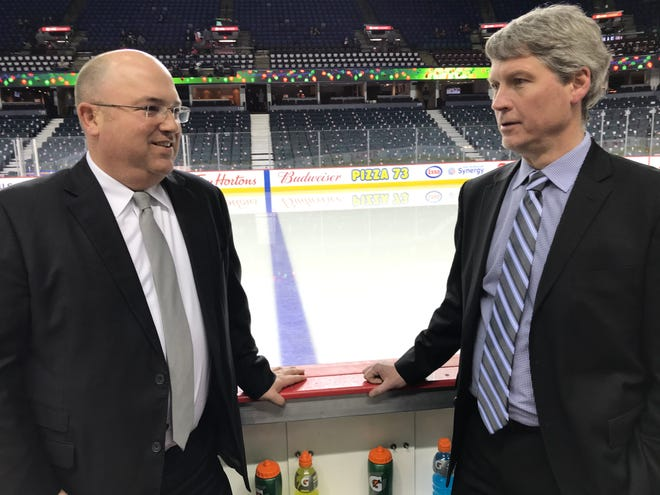 Brent Flahr, left, and Chuck Fletcher, right, worked together for nine seasons in Minnesota and were reunited this season in Philadelphia.