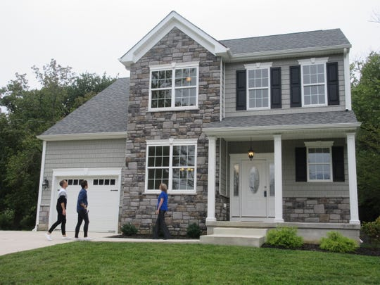 Patrick Bartscherer (left) and Eric Hillegass are used to renovating their homes, but see something different in this new-construction Collingswood property during an episode of HGTV's 'House Hunters' that airs Tuesday.