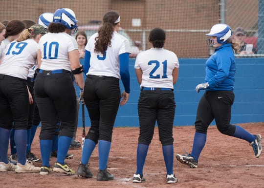 Chillicothe's Hanna Griffey is met by fellow teammates as she scores for Chillicothe after hitting a home run Saturday morning at Mt. Elementary during the first game of a double header with Zane Trace.
