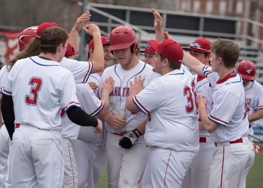 Zane Trace's Tanner Congrove celebrates with his teammates after hitting a home run for the Pioneers Saturday afternoon at the VA Memorial Stadium. Zane Trace fell to Athens 13-5.