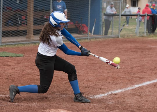 Chillicothe's Alysia Cunningham hits a home run Saturday morning at Mt. Elementary during the first game of a double header with Zane Trace.