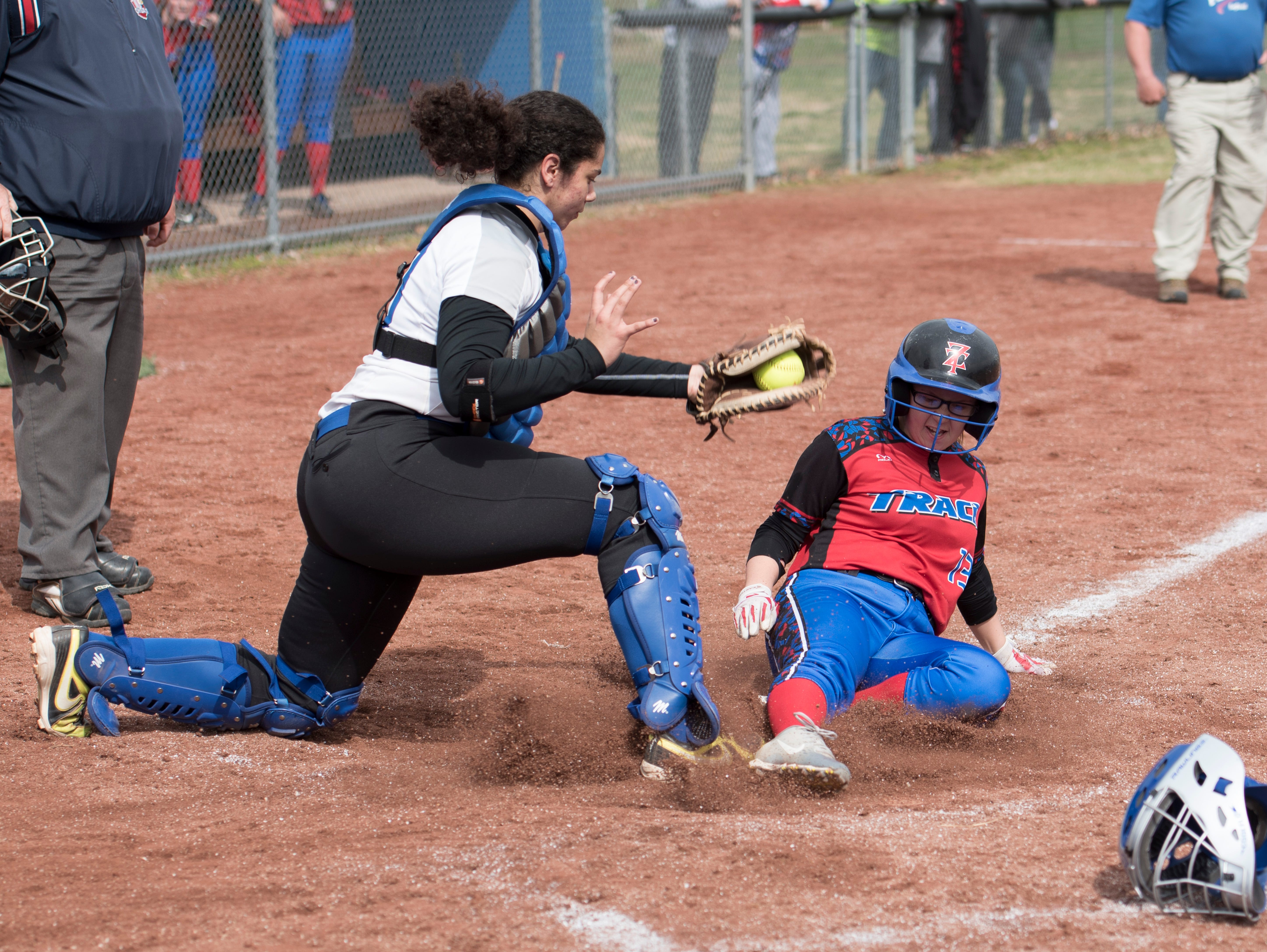 Chillicothe catcher Meliah Johnson attempts to tag Zane Trace's Makenzie Lunsford out as she slides into home during the first of two double header games at Mt. Logan Elementary. Zane Trace went on to win the first game 10-7.