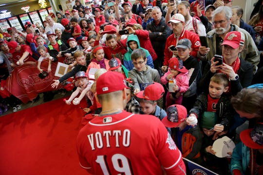 Cincinnati Reds first baseman Joey Votto (19) walks the red carpet during Kids Opening Day before an MLB baseball game against the Pittsburgh Pirates, Saturday, March 30, 2019, at Great American Ball Park in Cincinnati. Votto is five players signed for 2020.