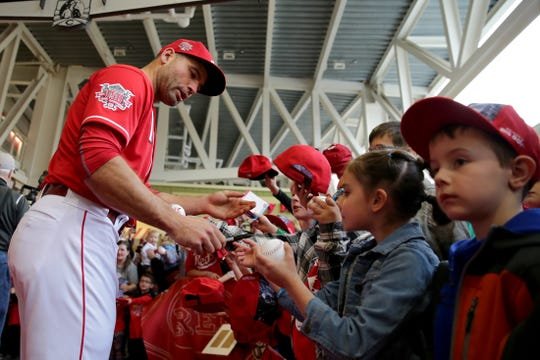 Cincinnati Reds first baseman Joey Votto (19) walks the red carpet during Kids Opening Day before an MLB baseball game against the Pittsburgh Pirates, Saturday, March 30, 2019, at Great American Ball Park in Cincinnati. Votto is one of five players signed for 2020.