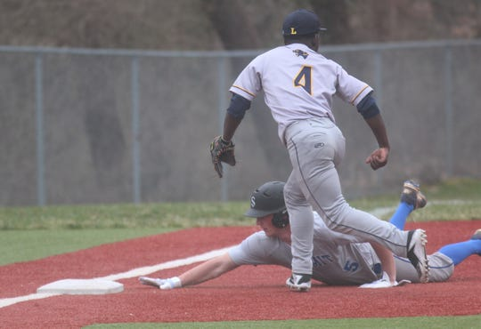 SCD senior Will Eads slides into third base safely ahead of the tag by Lockland sophomore Tiontae Hicks as Summit Country Day defeated Lockland 21-0 in a baseball game at SCD's home field in Cincinnati. It was the 200th career win for SCD head coach Triffon Callos, March 29, 2019.