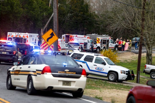 First responders and law enforcement officers investigate the scene of a wreck that killed two and left one critically injured on Lylewood Road near John Taylor Road in Woodlawn, Tenn., on Friday, March 29, 2019.