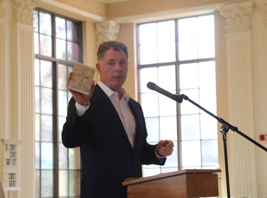 NY Giants Head Coach Pat Shurmur holds up his prayer book as he spoke at the Men's Lenten Afternoon of Prayer in the Year of Spiritual Awakening at St. James RC Church in Basking Ridge on March 30, 2019.