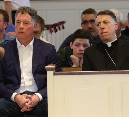 NY Giants head coach Pat Shurmur sitting with Bishop James F. Checchio after Shurmur spoke at the Men's Lenten Afternoon of Prayer in the Year of Spiritual Awakening at St. James RC Church in Basking Ridge on March 30, 2019.