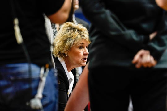 Iowa Hawkeyes head coach Lisa Bluder talks to her players during a timeout against the NC State Wolfpack during the second half in the semifinals of the Greensboro regional in the women's 2019 NCAA Tournament at Greensboro Coliseum.