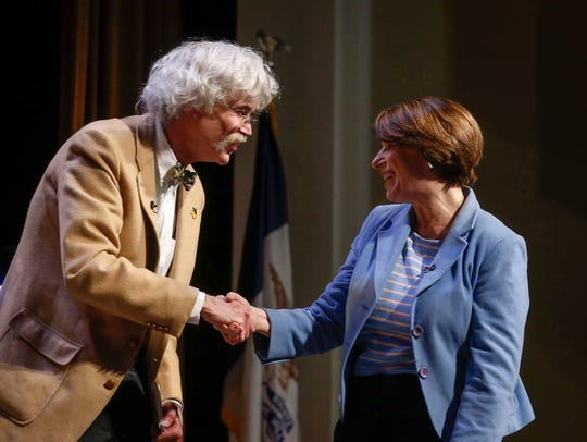 Storm Lake Times editor and co-owner Art Cullen greets Democratic presidential candidate hopeful Amy Klobuchar during the Storm Lake Times political forum in Storm Lake on March 30, 2019.