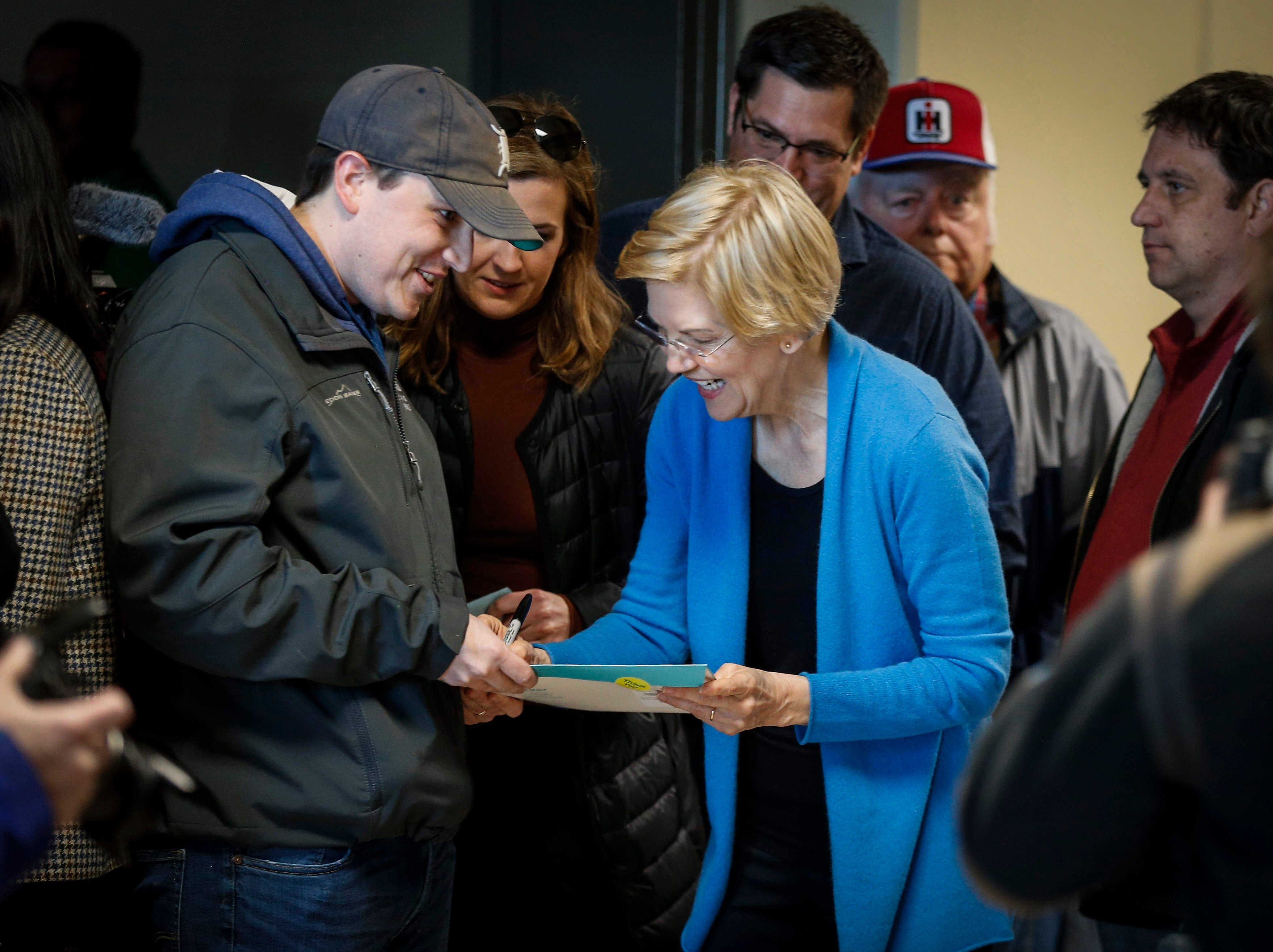Democratic presidential candidate hopeful Elizabeth Warren signs an autograph during the Family Farm Action rally in Storm Lake on March 30, 2019.