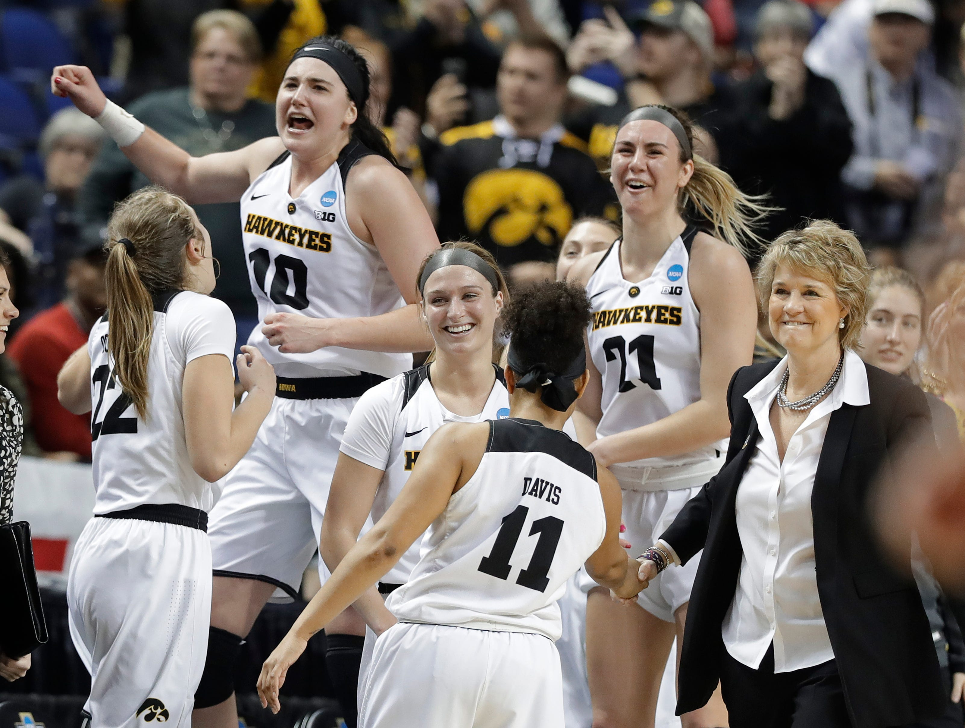 Iowa players including Megan Gustafson (10) and Hannah Stewart (21) celebrates in the closing seconds of the second half of a regional women's college basketball game against North Carolina State in the NCAA Tournament in Greensboro, N.C., Saturday, March 30, 2019.