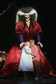 """A 15-foot-tall witch towers over the stage in """"Hansel and Gretel."""""""