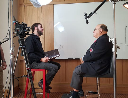 Director Joshua Riehl interviews coach Scotty Bowman at the 2015 Hall of Fame Inductions.
