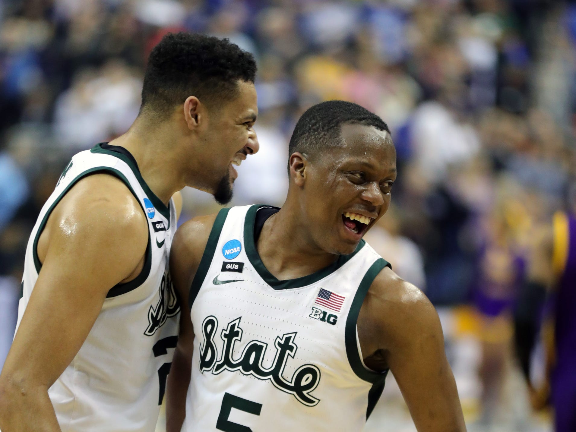 Michigan State's Kenny Goins and Cassius Winston celebrate MSU's 80-63 win over LSU in the NCAA tournament on Friday, March 29, 2019, in Washington.
