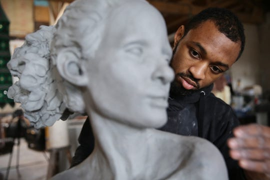 Austen Brantley, 23, a self-taught clay sculptor, works in his studio at the 822 Gallery in Royal Oak.