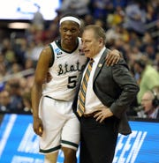 Cassius Winston and Tom Izzo embrace during MSU's win over LSU.
